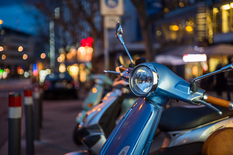 jupiter-3 50mm 1.5 sony alpha 7s bokeh blue hour citylights vespa